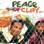 two men stand behind a link fence as one is holding a basketball and the other is looking out to the distance. The title, Peace of Clay, is written above the men in three different colors