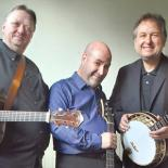 close up photo of the three Kruger brothers as they hold their instruments