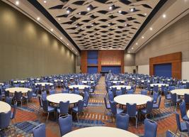 Photo of ballroom filled with circular tables and chairs